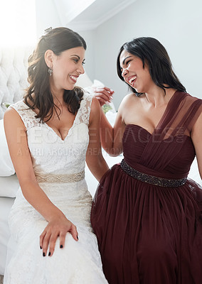 Buy stock photo Shot of the bride and maid on honor spending time together