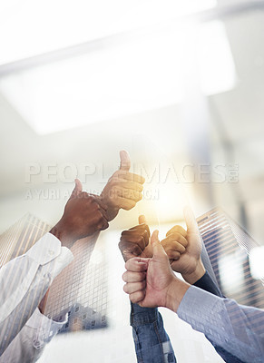 Buy stock photo Shot of skyscrapers superimposed over an unidentifiable business team giving a thumbs up