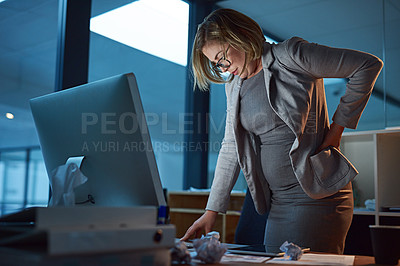 Buy stock photo Cropped shot of a businesswoman suffering from backache while working late in the office