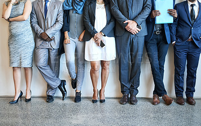 Buy stock photo Cropped shot of a group of unidentifiable businesspeople standing in line while waiting to be interviewed