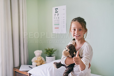 Buy stock photo Shot of a little girl holding her stuffed monkey while visiting the doctor