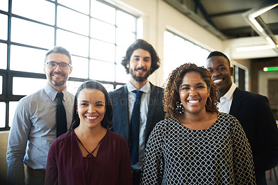 Buy stock photo Portrait of a diverse team of happy businesspeople posing together in their office