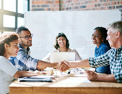 Buy stock photo Shot of a team of entrepreneurs collaborating in a modern office
