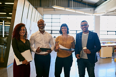 Buy stock photo Portrait of a group of designers posing together in their office