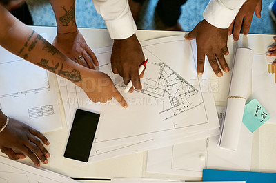 Buy stock photo Cropped shot of a group of architects collaborating on a project