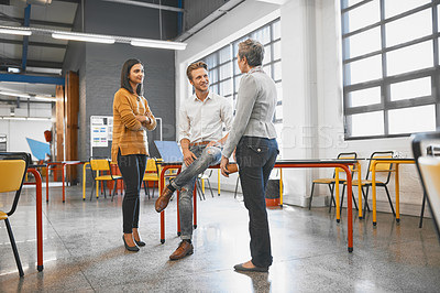 Buy stock photo Full length shot of three creative business colleagues chatting in their office