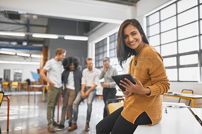 Buy stock photo Cropped portrait of an attractive young businesswoman in the office with his colleagues in the background