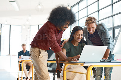 Buy stock photo Shot of a group of creative designers hard at work in their modern office