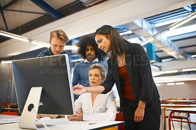 Buy stock photo Cropped shot of a team of designers working together on a computer in their office