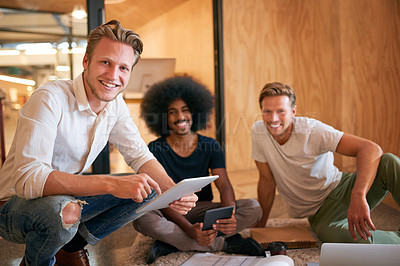 Buy stock photo Portrait of a team of designers brainstorming on the floor in an office