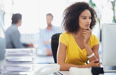 Buy stock photo Shot of an attractive young businesswoman working in an office with her colleagues in the background