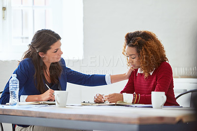 Buy stock photo Cropped shot of an attractive young businesswoman reassuring a female colleague in the office