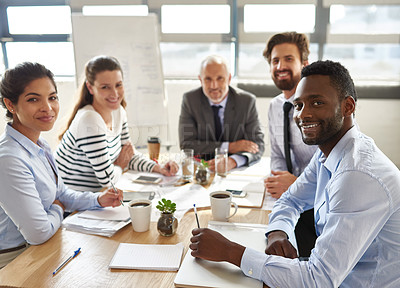 Buy stock photo Cropped portrait of a group of businesspeople sitting around a table in the boardroom