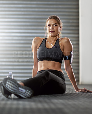 Buy stock photo Shot of an athletic young woman working out