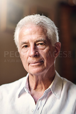 Buy stock photo Portrait of a serious senior man at home