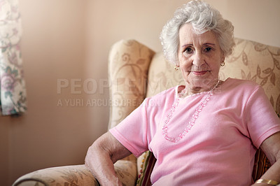 Buy stock photo Portrait of a senior woman relaxing on a chair at home