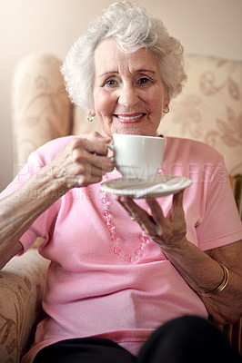 Buy stock photo Portrait of a senior woman enjoying a warm beverage at home