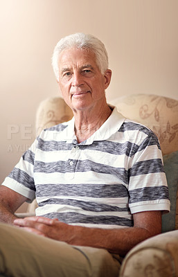Buy stock photo Portrait of a senior man relaxing on a chair at home