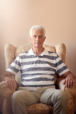Buy stock photo Portrait of a senior man sitting on a chair at home
