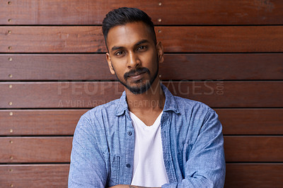 Buy stock photo Portrait of a handsome young man posing against a brown background outside