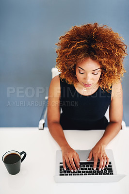 Buy stock photo Cropped shot of a young businesswoman working on her laptop