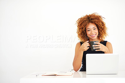 Buy stock photo Portrait of a young businesswoman working on a laptop at her desk
