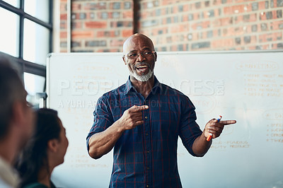 Buy stock photo Cropped shot of a mature businessman giving a presentation in the boardroom