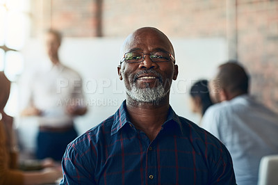 Buy stock photo Cropped portrait of a mature businessman sitting in the boardroom during a presentation