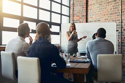 Buy stock photo Cropped shot of a young pregnant businesswoman giving a presentation in the boardroom