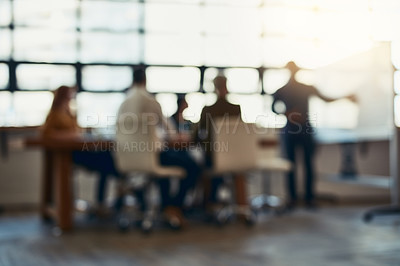 Buy stock photo Full length bokeh shot of a group of corporate businesspeople meeting in the boardroom