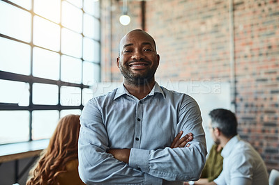 Buy stock photo Cropped shot of a businessman standing in the office with his arms folded looking confident and smiling at the camera