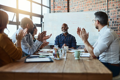 Buy stock photo Cropped shot of a group of businesspeople in the office applauding a colleague after a successful group meeting