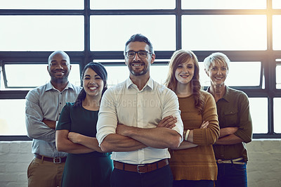 Buy stock photo Portrait of a team of colleagues standing together in a modern office