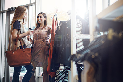 Buy stock photo Shot of two girlfriends out on a shopping spree together