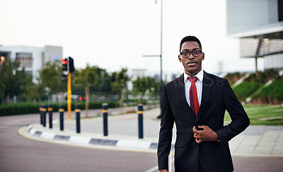 Buy stock photo Portrait of a serious young businessman walking to work
