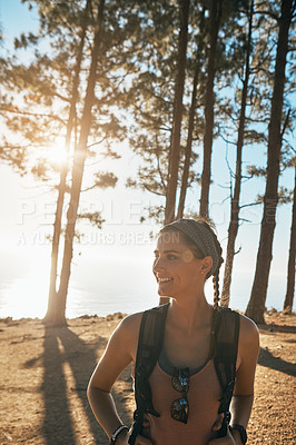 Buy stock photo Shot of a young woman out on a hike in the forest