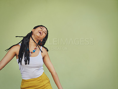 Buy stock photo Shot of an attractive young woman feeling free against a green background