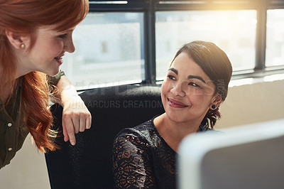 Buy stock photo Shot of two designers working together on a computer in an office
