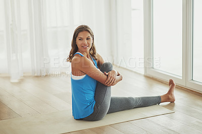 Buy stock photo Full length shot of a young woman practicing yoga at home