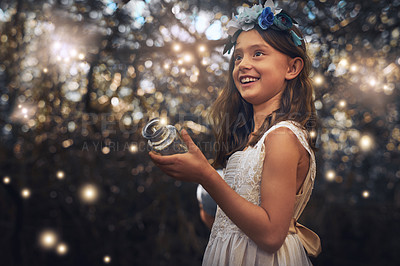 Buy stock photo Shot of a little girl catching fireflies in a jar outside