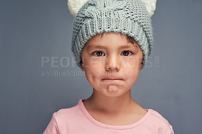 Buy stock photo Studio portrait of an adorable little boy posing against a gray background