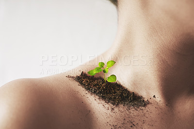 Buy stock photo Shot of an unidentifiable young woman's shoulder with soil and a small seedling on it