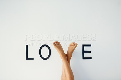 Buy stock photo Closeup shot of an unrecognizable person's crossed legs with his feet making up the letter