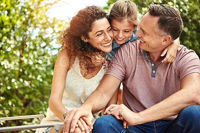 Buy stock photo Shot of a family of three enjoying a day outdoors