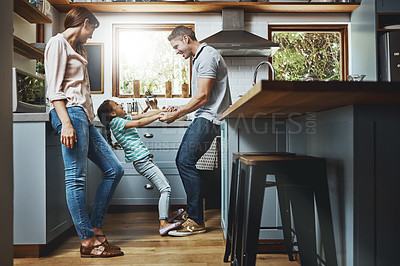Buy stock photo Shot of a family playing together in the kitchen at home