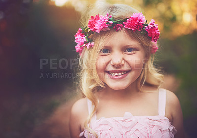Buy stock photo Shot of a happy little girl looking at the camera and smiling while standing in the middle of a dirt road