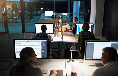 Buy stock photo Shot of businesspeople working late in an office