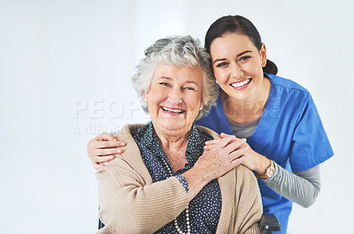 Buy stock photo Portrait of a caring young nurse posing with her elderly patient during a consultation in the clinic