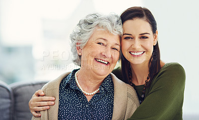 Buy stock photo Portrait of a happy young woman spending time with her elderly relative at home