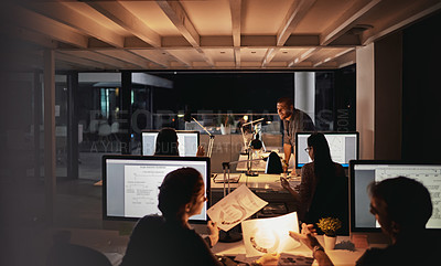 Buy stock photo Shot of creative employees working late in the office